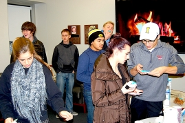 The Academy students enjoy hot chocolate and holiday cookies at the last seminar of the fall semester.