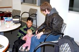 Phuc Le (l) and Austin Henderson (r) play with Ellen.