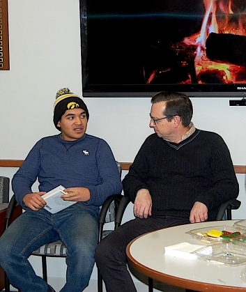 Juan Tello (l) chats with Administrator of Bucksbaum Academy, David Gould (r).